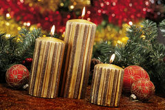 Christmas baubles, candles and other on background of defocused Royalty Free Stock Photos
