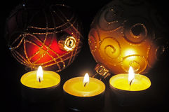 Christmas baubles and candles Stock Photography