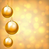 Christmas baubles. Christmas card with hanging baubles on golden background Stock Photography