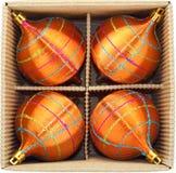 Christmas Baubles in Cardboard Box. Orange Christmas Baubles in Cardboard Box Stock Photos