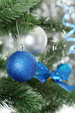 Christmas baubles on christmas tree, close up Stock Photography