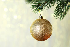 Christmas baubles on christmas tree on lights background Royalty Free Stock Photo