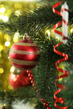 Christmas baubles on christmas tree on lights background Royalty Free Stock Photography