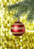 Christmas baubles on christmas tree on lights background Stock Photography