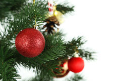 Christmas baubles on christmas tree on white background, close up Royalty Free Stock Image