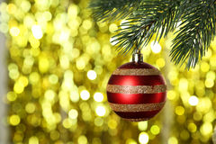 Christmas baubles on christmas tree on yellow background Stock Photography