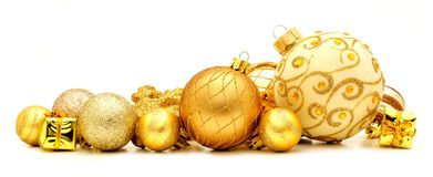 Christmas baubles. Collection of golden Christmas baubles forming a border Royalty Free Stock Photos
