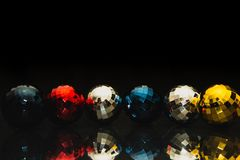 Christmas baubles colorful motive, dark background. Colorful christmas baubles motive. Decorations for cards, backgrounds. Yellow, red, blue and silver balls royalty free stock image