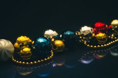 Christmas baubles colorful motive, glossy and dark background royalty free stock photography