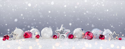 Christmas Baubles Decoration And Snowfall stock photo