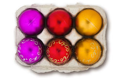 Christmas Baubles in an Eggbox. Isolated eggbox full of colorful Christmas baubles Stock Image