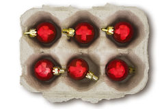 Christmas Baubles in an Eggbox. Isolated eggbox full of red Christmas baubles Stock Photos