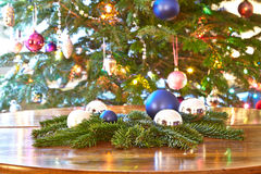 Christmas, baubles and evergreens on table, Christmas tree Stock Photos