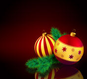 Christmas baubles with fir branch. Red and golden Christmas baubles with fir branch Stock Images