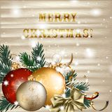 Christmas baubles with fir branches on wooden background Royalty Free Stock Images