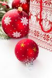 Christmas Baubles and fir tree branches Stock Photography