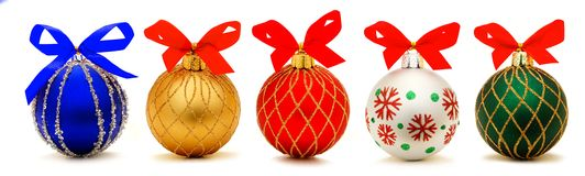 Christmas baubles. Five unique Christmas bauble decorations with bows isolated on white Stock Photography