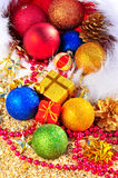 Christmas baubles and gift boxes on the san Stock Photography