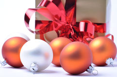 Christmas baubles and gift isolated on white Stock Images