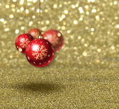 Christmas baubles on gold glitter background. Christmas background with baubles on gold glitter Royalty Free Stock Photo