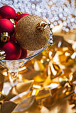 Christmas baubles gold and red in wineglass Stock Photos