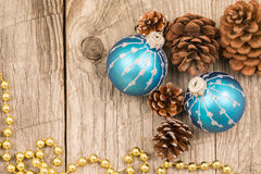 Christmas baubles, golden beads and pine cones top view Royalty Free Stock Photo