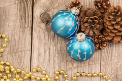Christmas baubles, golden beads and pine cones top view Stock Image