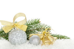 Christmas baubles and golden ribbon with snow fir tree Royalty Free Stock Images