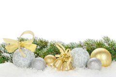 Christmas baubles and golden ribbon with snow fir tree Royalty Free Stock Photography