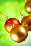 Christmas baubles on green background Stock Photography