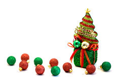 Christmas baubles and green box top with christmas tree Royalty Free Stock Photos