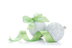 Christmas baubles and green ribbon Stock Photo