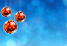 Christmas background. Christmas baubles hanging on blue background with snowflakes Stock Photography