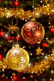 Christmas baubles hanging on christmas tree Royalty Free Stock Photo