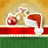 Christmas baubles and hat on cardboard background Royalty Free Stock Photos