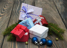 Christmas baubles  with heap of gift boxes Stock Photography