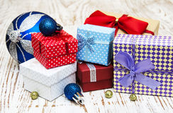 Christmas baubles  with heap of gift boxes Royalty Free Stock Photography