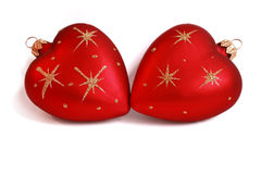 Christmas baubles with heart form Stock Images