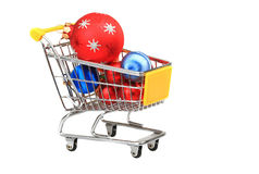 Christmas baubles inside shopping trolley. On white background Royalty Free Stock Photography