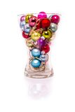 Christmas baubles with lights in a vase Stock Images