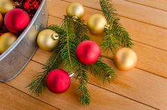 Christmas Baubles and needles on a Table Royalty Free Stock Image
