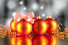 Christmas baubles, ornaments and pink bow Royalty Free Stock Images