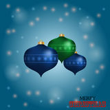 Christmas baubles over blue glowing background Royalty Free Stock Photos