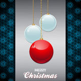 Christmas baubles over brushed metallic panel with text Royalty Free Stock Photography