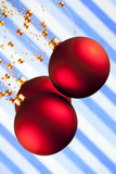 Christmas baubles on patterned background Stock Photo