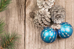 Christmas baubles and pine cones Royalty Free Stock Images