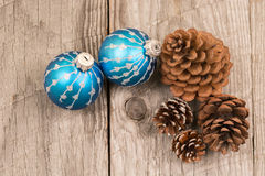 Christmas baubles and pine cones top view Stock Images