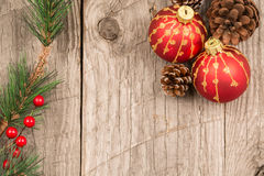 Christmas baubles and pine cones top view Royalty Free Stock Photos