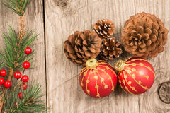 Christmas baubles and pine cones top view Royalty Free Stock Images