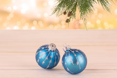 Christmas baubles and pine tree branch Stock Photos